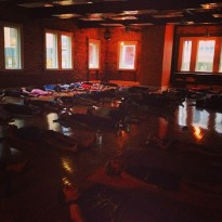 Students at Bodhi Tree Yoga relaxing in savasana.