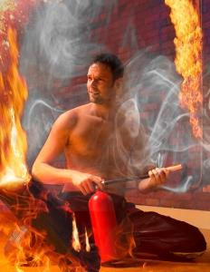 Colin kneeling in fire